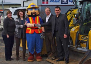 Proceeds from Little Diggers Day Presented. Equipment World presents $4,000 cheque to Habitat for Humanity Thunder Bay, November 14, 2014 Featured in Photo, Left to Right: Diane Mitchell (Habitat for Humanity CEO), Heather Syvitski, Freddy the Mascot, Lyle Knudsen & Peter Knudsen (Equipment World Owners)