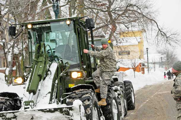 New York Army National Guardsmen employ engineering equipment to remove snow in Buffalo, N.Y., Nov. 20, 2014. More than 500 Guard members are supporting response and recovery efforts following historic amounts of snowfall in western New York State. U.S. Air National Guard photo by Senior Master Sgt. Ray Lloyd