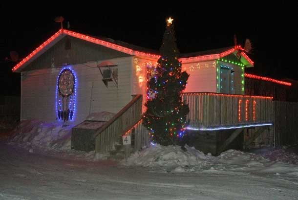 Dreamcatcher in lights on home in Attawapiskat - Photo by Rosiewoman Cree