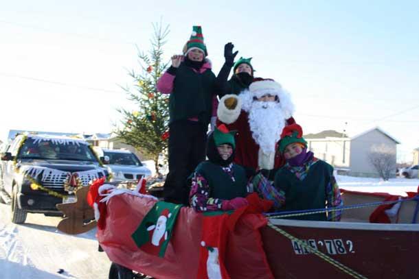 Santa visiting Attawapiskat for the 2014 Christmas Parade. Photo by Rosiewoman Cree