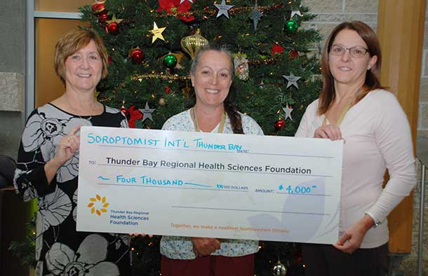 Carol Young of Soroptimist International Thunder Bay presents its annual donation to the Health Sciences Centre's Sexual Assault/Domestic Violence Treatment Centre to Melody McGregor, Follow-Up Outreach Nurse with the Centre and Dawn MacDonald, Manager, Ambulatory Care Services & SA/DVTC.