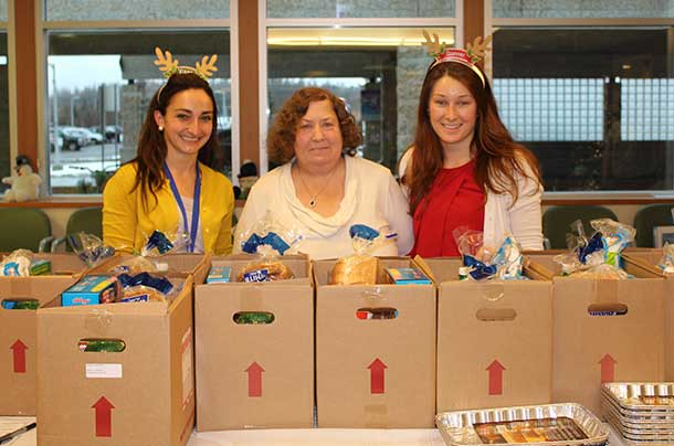 Renal patient, Debbie Sohlman (middle), picks up her specially-made Christmas hamper for renal dialysis patients from Thunder Bay Regional Health Sciences Centre's Renal Services Registered Dietitians, Michelle Lawrence (left) and Holly Freill (right).