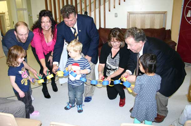 With help from some children, LUSU President Ian Kaufman; Tammy Squitti, Nanabijou Board Chair; Lakehead President and Vice-Chancellor Dr. Brian Stevenson; Norine Carroll, executive assistant to MPP Bill Mauro; and Michael Gravelle, Minister of Northern Development and Mines and Chair of the NOHFC cut a paper ribbon to celebrate the opening of the Nanabijou Childcare Centre.