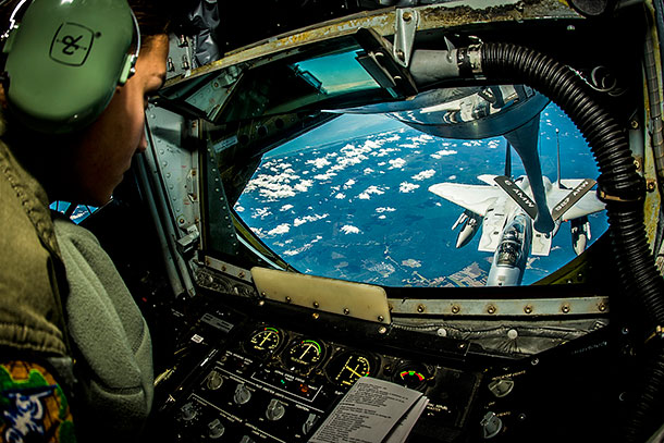 Air Force Senior Airman Crystal Cash refuels an F-15 during exercise Vigilant Shield 15 over the United States, Oct. 20, 2014. The annual exercise is designed to integrate Defense Department and civil response in support of the national strategy of aerospace warning and control, defense support of civil authorities and homeland defense. U.S. Air Force photo by Tech. Sgt. Brandon Shapiro