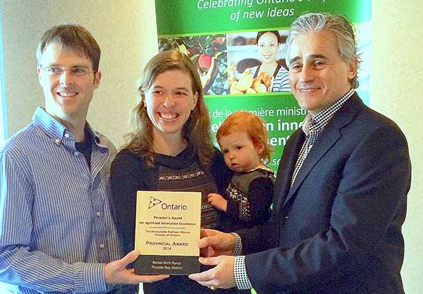 Award recipients Dave Challen and Beth Kuiper, Owners of Boreal Birch Syrup in Murillo, with their daughter Paige and MPP Mauro.