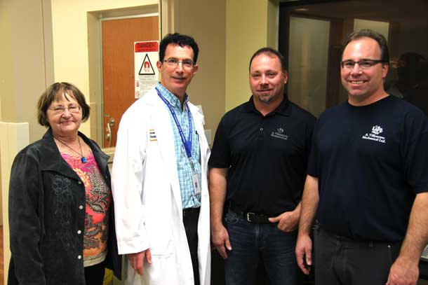l-r Sandra, Jason and Jeff Villeneuve met with Dr. Mitchell Albert (2nd from left) to discuss his new research into imaging technology which will help in testing and evaluating lung disease treatments. $25,000 from the Anthony Villeneuve Memorial Endowment Fund was donated to the research project which was set up in honour of husband and father, Tony, who passed away from mesothelioma.