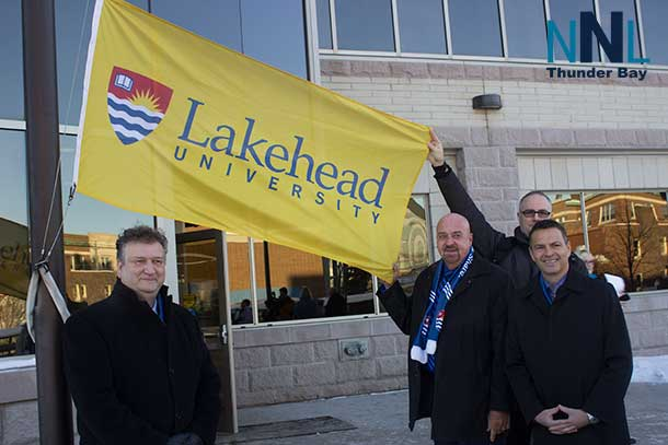 Dr. Brian Stephenson, Mayor Keith Hobbs and Murray Walberg raise the flag at City Hall