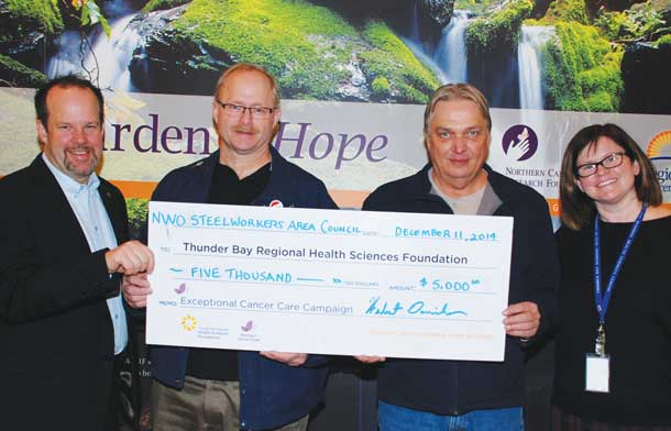 ", Herb Daniher, local USW Staff Representative together with Bruce Frost, Northwestern Ontario Steelworkers Area Council President present their $5,000 donation on behalf of its membership and fallen brethren (see sidebar) to Andrea Docherty, Program Director, Regional Cancer Care Northwest and Glenn Craig, President and CEO of the Health Sciences Foundation. ""The Exceptional Cancer Care campaign is truly a regional initiative benefiting all of the people of Northwestern Ontario,"" says Daniher."