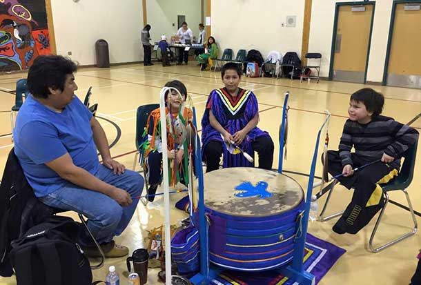 Drumming in Neskantaga First Nation at Pow Wow