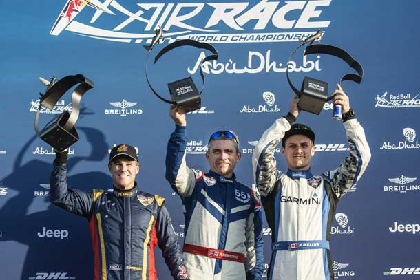 Matt Hall of Australia (L), Paul Bonhomme of Great Britain (C) and Pete McLeod of Canada (R) celebrate during the Award Ceremony of the first stage of the Red Bull Air Race World Championship in Abu Dhabi, United Arab Emirates on February 14, 2015. Photographer Credit Joerg Mitter / Red Bull Content Pool