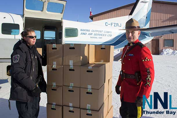 During the Toys for the North Trip, NAPS Officers and RCMP Officers unloaded water in Ogoki Post