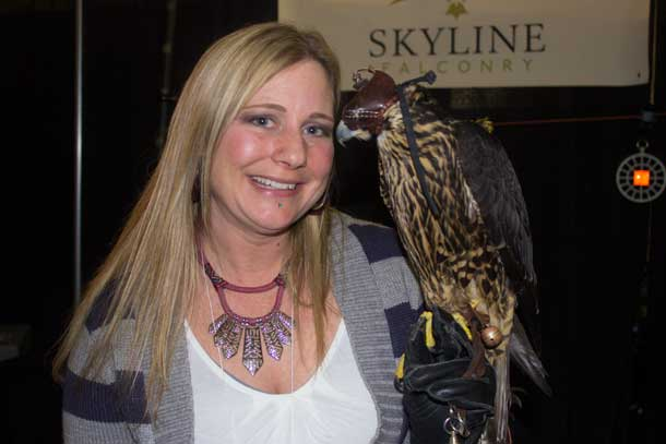 Kym shows off a beautiful Falcon at the Central Canada Outdoor & Recreation Show
