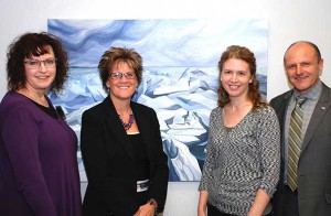The Travelling Painting, at home at Investors Group in January, with (l-r) Laura Fralick, owner of the painting, Donna Yocom, Regional Director of Investors Group Financial Services Inc., Colleen Rose, artist of the painting, and Dan Bissonnette, Health Sciences Foundation. This month it is at Shout Media, then on to Lisa Sandham Interior Design for the month of March.