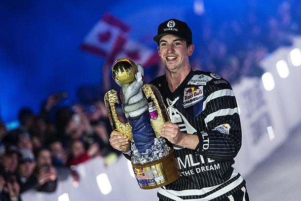 Scott Croxall of Canada celebrates during the Award Ceremony of the fourth stage of Red Bull Crashed Ice, the Ice Cross Downhill World Championship in Edmonton, Canada on March 14, 2015.