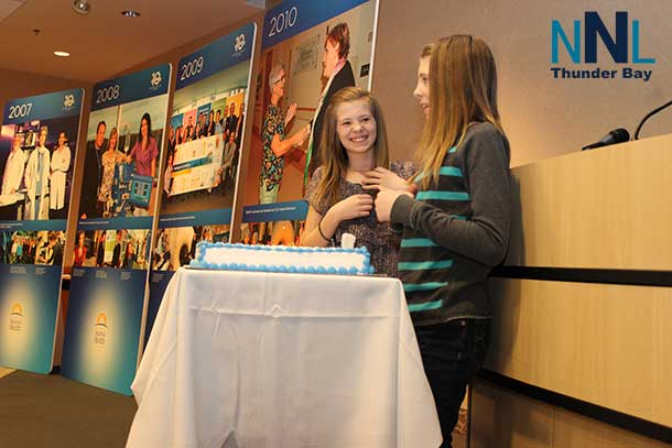 Blowing out the birthday candles at the 10-year celebration launch last year were Lauren and Julia (above), the first twins born at Thunder Bay Regional Health Sciences Centre on February 26, 2004.