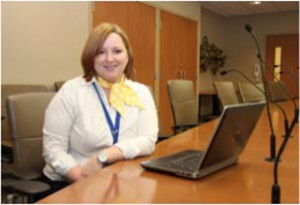 Jessica Nehrebecky, Board Liaison, is shown here preparing for a recent open meeting of the TBRHSC Board of Directors. Webcasting makes it possible for anyone interested in the decisions being made about the hospital to watch the open meetings from home, whether it's in Thunder Bay, across Northwestern Ontario, or beyond.