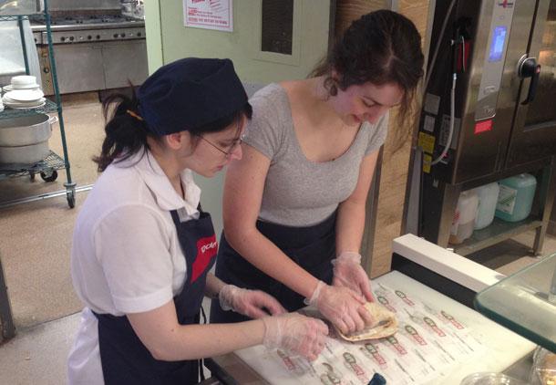 Sodexo Employee Patricia Bordignon (left), Teaches Aly How to Make the Perfect Pita