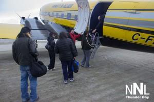 Passengers embark on First Cargo North Charter passenger service on the Basler