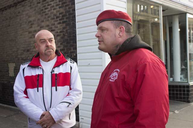 Mayor Hobbs and Ian Hodgkinson walking and talking with film crew