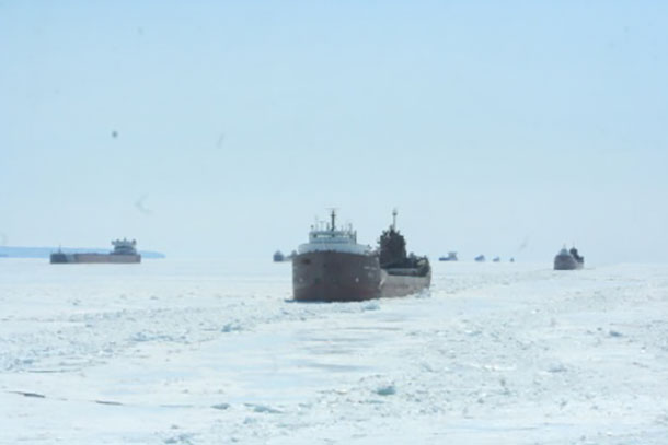 Vessels carrying commodities to and from ports throughout the Great Lakes wait on eastern Lake Superior while U.S. and Canadian Coast Guard ice breakers create tracks for the vessels to continue transiting April 7, 2015. Ongoing ice breaking operations are part of the Spring Breakout phase of Operation Taconite. (U.S. Coast Guard photo courtesy of Coast Guard Cutter Alder)