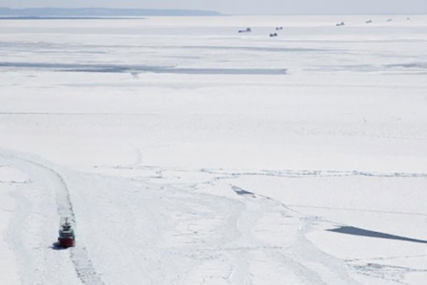 The Canadian Coast Guard Cutter Samuel Risley continues ice breaking operations on eastern Lake Superior, creating tracks that will enable 18 vessels currently being staged to continue transiting to and from the lower Great Lakes, April 7, 2015. Ongoing ice breaking operations with U.S. Coast Guard ice breakers are part of the Spring Breakout phase of Operation Taconite. (Photo courtesy of Canadian Coast Guard)