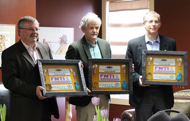 Confederation College President Madder (left) with Trent University President & Vice Chancellor Dr. Leo Groarke and FNTI President & CEO Derek Sagima Participate in a Traditional Gift Giving Ceremony