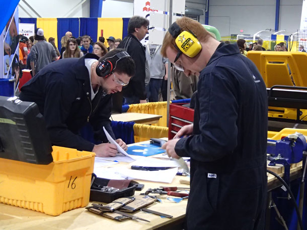 Silver Medalist Don Mills (left) and Fellow Student Brent Berube Work on their Sheet Metal Projects during the Competition