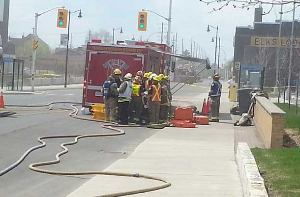 Fire Fighters prepare to go remove the suspicious package from the Court House