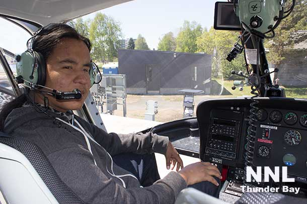 Ready for take-off or ready to take a picture? Munzeroy at the control of the Expedition Helicopter.