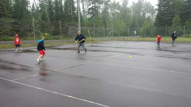 Playing tennis at Camp Quality