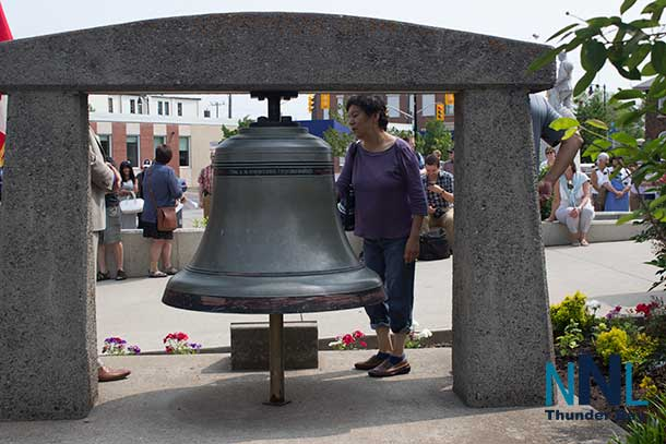 Ringing the Peace Bell during Ceremony at Thunder Bay City Hall