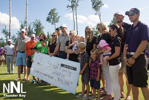 Cheque presentation on the 18th green at Whitewater Golf Club at the 2015 Staal Foundation Open presented by Tbaytel