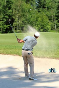 Ted Smith, a 31 year old from Ohio, chipping out of the sand trap on the 10th hole