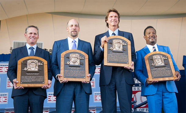 The Hall of Fame Class of 2015 -- Craig Biggio, Randy Johnson, Pedro Martínez and John Smoltz -- hold their new plaques at the Induction Ceremony on Sunday at the Clark Sports Center in Cooperstown. (Milo Stewart, Jr. / National Baseball Hall of Fame)