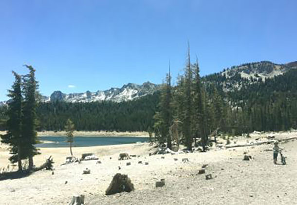 This image shows an abnormally low lake level at Horseshoe Lake in the high-elevation Mammoth Lakes Basin, Sierra Nevada Mountains, This photo was taken June 2015. Photo by Jennifer Bernstein