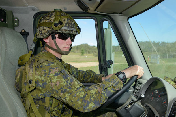 Private Alex Desjardins behind the wheel of a Medium Support Vehicle System (MSVS).