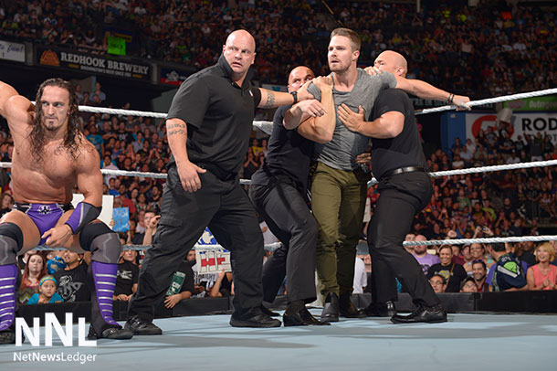 WWE® Security restrains Red Arrow Star Stephen Amell after brawl with Stardust