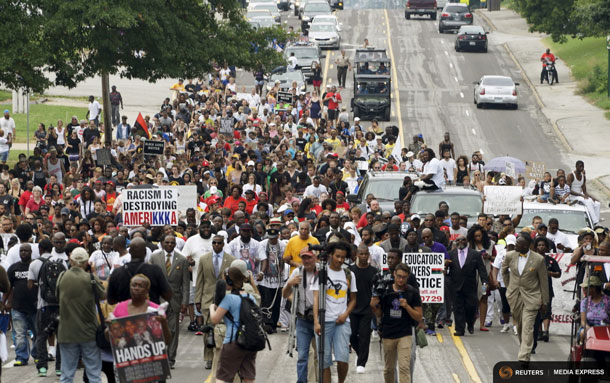 (Reuters) Protestors took to the streets marking the one year anniversary of the shooting of an unarmed black teenager