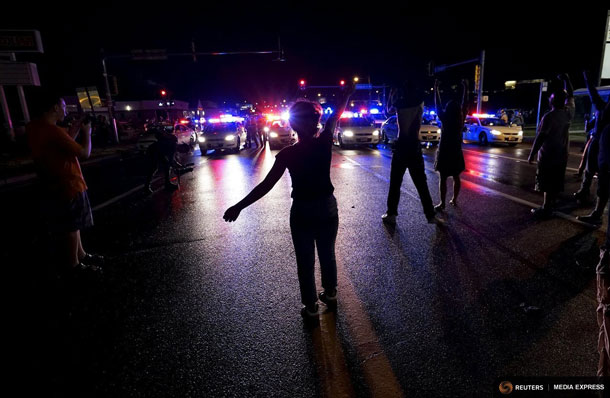 Reuters - Residents in Ferguson Rally on the one year anniversary of the shooting of an unarmed black man