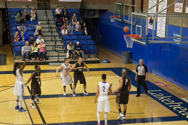 Anthony Flores #24 at the Free Throw Line - in a very hard fought basketball game