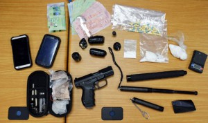 Thunder Bay Police Image showing weapons, cash and drugs seized in drug bust in Westfort