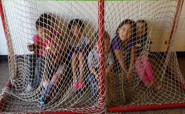 Hockey nets and the imagination of young people can mean anything - Here the youth are behind the spiderweb