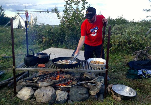 Volunteer Steve Berry fries up some fresh whitefish