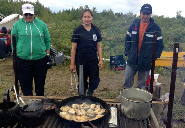 Mary Jane Wabano, Renee Hunter and Kaitlyn Hunter fry up fresh fish for lunch.