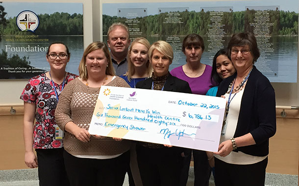 The Sioux Lookout Meno Ya Win Health Centre was the recipient of a grant for $6,786.13 from the Northern Cancer Fund of the Thunder Bay Regional Health Sciences Foundation to fund the purchase of an Emergency Shower in the Chemotherapy Preparation Anteroom for pharmacy staff. Pictured here from left to right are: Renée Soulliere, Pharmacy Aide, SLMHC; Devon Sokoloski, Special Events Officer, Thunder Bay Regional Health Sciences Foundation; Frank Head, Representative, Tbaytel; Megan Upton, Executive Coordinator, Thunder Bay Regional Health Sciences Foundation; Karen Parent, Director of Clinical Support Services, SLMHC; Sue Mittleholt, Pharmacy Aide Team Lead, SLMHC; Angela Brucelas, Pharmacy Aide, SLMHC; and Rita Demetzer, Treasurer, Sioux Lookout Meno Ya Win Health Centre Foundation.