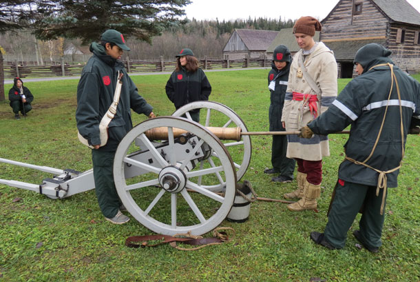 Junior Canadian Rangers prepare a canon for firing at Fort William Historical Park