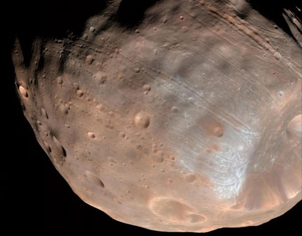 New modeling indicates that the grooves on Mars' moon Phobos could be produced by tidal forces -- the mutual gravitational pull of the planet and the moon. Initially, scientists had thought the grooves were created by the massive impact that made Stickney crater (lower right).
