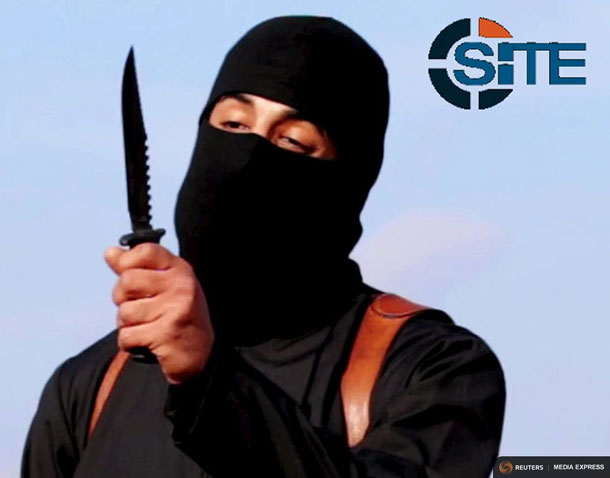 A masked, black-clad militant, who has been identified by the Washington Post newspaper as a Briton named Mohammed Emwazi, brandishes a knife in this still file image from a 2014 video obtained from SITE Intel Group February 26, 2015. REUTERS/SITE Intel Group/Handout via Reuters/Files