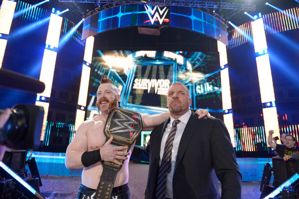 HHH wasted no time in celebrating with newly crowned WWE® Champion Sheamus.