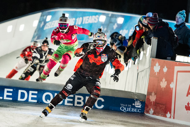 Cameron Naasz of the United States leads ahead of Dean Moriarity of Canada, Scott Croxall of Canada and Dylan Moriarity of Canada during the finals of the first stage of the Ice Cross Downhill World Championship at the Red Bull Crashed Ice in Quebec City, Canada on November 28, 2015.